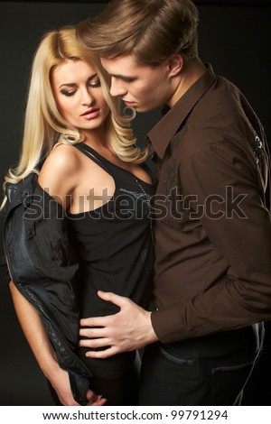 Sexy young couple wearing jeans in the studio