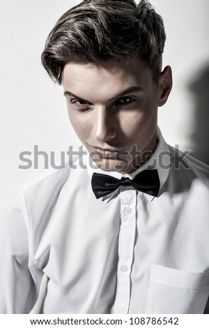 Sexy young elegant man on white - stock photo