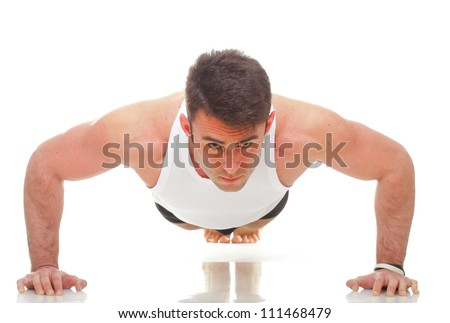 Sexy Young fashion sport man, fitness muscle model guy making push ups exercise white background
