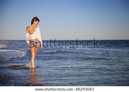 Sexy young girl in bikini on the beach
