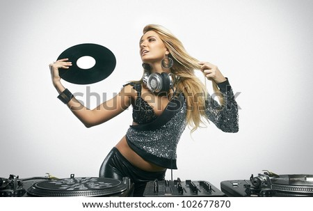 Sexy young girl posing at the professional vinyl record players