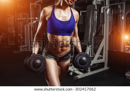 sexy young girl resting after sport workout exercises. Fitness woman in sport wear with perfect fitness body resting in gym