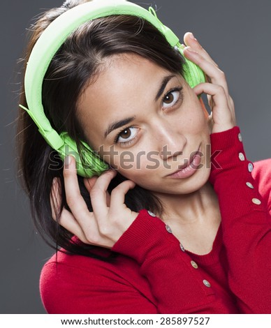 sexy young girl with earphone on for sound relaxation