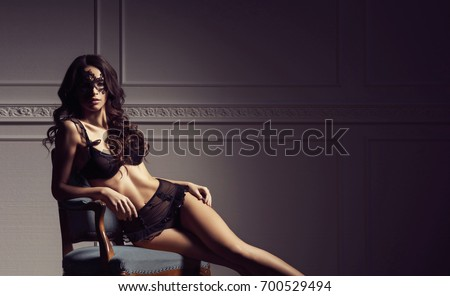 Sexy young lady in erotic lingerie posing in vintage interior
