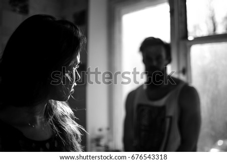Sexy young man with his beautiful girlfriend standing in kitchen at home talking by the window. #676543318
