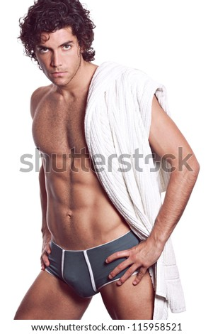 Sexy young muscular man with grey underwear and white towel . Isolated on white