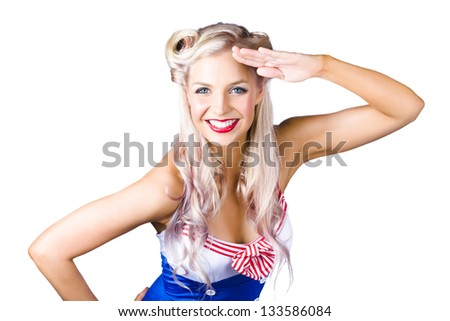 Sexy young pin-up woman in retro sailor outfit saluting, white background