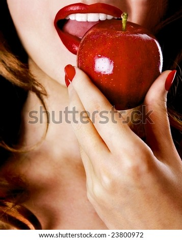 Sexy young pretty woman / model / girl / student / businesswoman / secretary with pink lips, vintage / retro is eating an apple / lips / seductive - closeup
