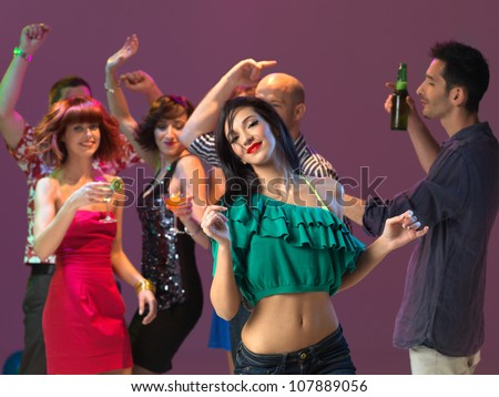 sexy, young woman dancing on the dancefloor, in a night club
