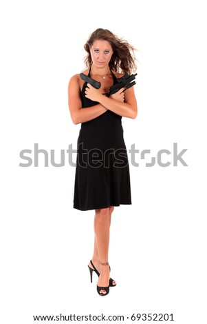Sexy young woman in black dress holding a handgun and an automatic gun. Studio shot. White background