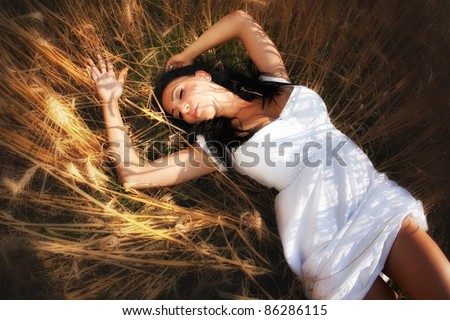Sexy young woman in grain field