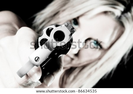 Sexy young woman pointing a gun Focus is on Gun