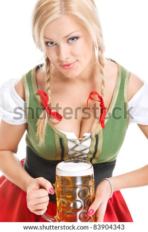 sexy young woman wearing a dirndl with beer mug over white