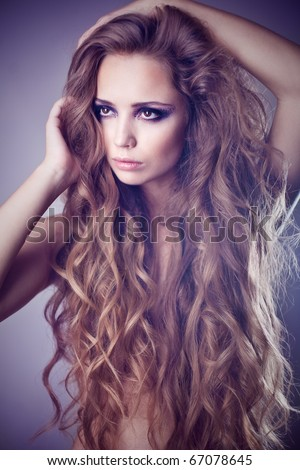 Sexy young woman with beautiful long hair