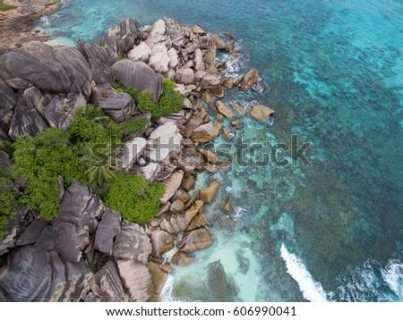 Seychelles Island, turquoise sea and granite rocks aerial landscape. La Digue Grand Anse beach seascape.