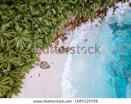 Seychelles Tropical Island Praslin with white beach and tropical palm trees, Drone aerial view over Seychelles Stock photo ©