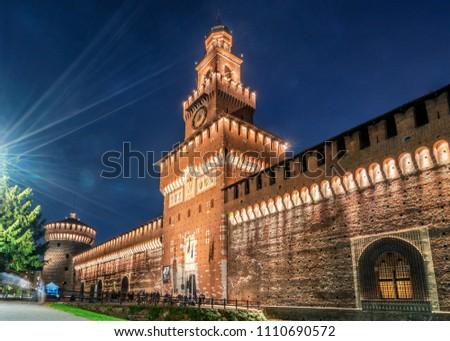 Sforza Castle (Castello Sforzesco) at night in Milano, Italy. The castle was built in the 15th century by Sforza, Duke of Milano. It is the main travel destination for tourist visiting Milano, Italy. #1110690572