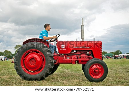 SHABBINGTON, ENGLAND - AUGUST 6: Mc Cormick B250 tractor parades around the main showmans ring for the on-looking public at the Great Bucks Steam & Country fair on August 6, 2011 at Shabbington