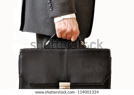 Shabby black leather briefcase in male hand