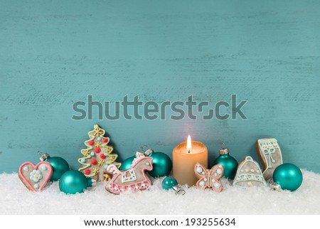 Shabby chic christmas background with candle and gingerbread. #193255634