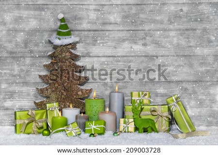Shabby chic green and white christmas decoration on grey wooden background with snowflakes. #209003728