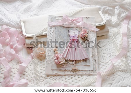 Shabby chic scrap-booking card with handmade paper dress in pastel colors #547838656