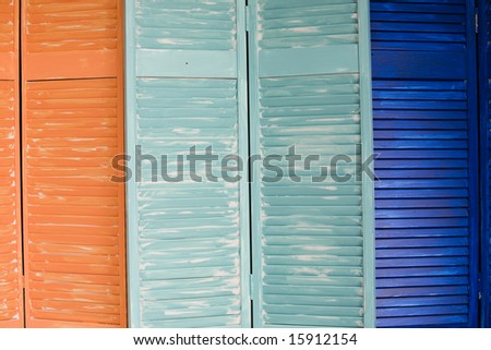 shabby chic shutter background with a tropical flair