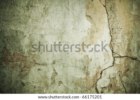 Shabby cracked wall green grunge background with dark borders