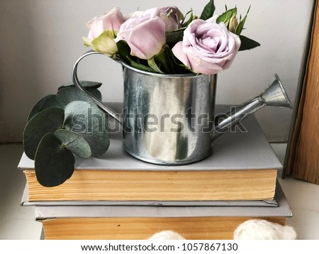 shabby roses on books. wallpaper with small purple roses for shabby background #1057867130