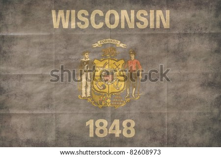 Shabby Wisconsin flag, closeup background.