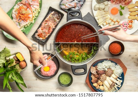 Shabu-shabu is a Japanese nabemono hotpot dish of thinly sliced meat and vegetables boiled in water. The term is onomatopoeic, derived from the sound emitted when the ingredients are stirred Stockfoto ©
