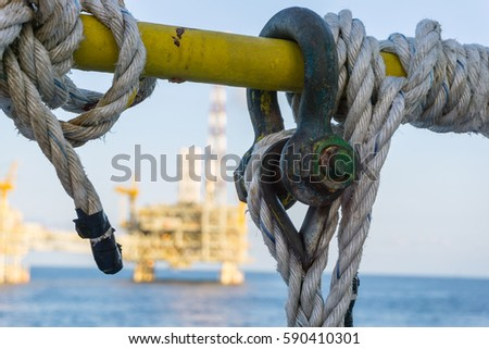 shackle on handrail at...