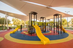 Shaded kid's playground activity tower equipment at the Lake park in Abu dhabi