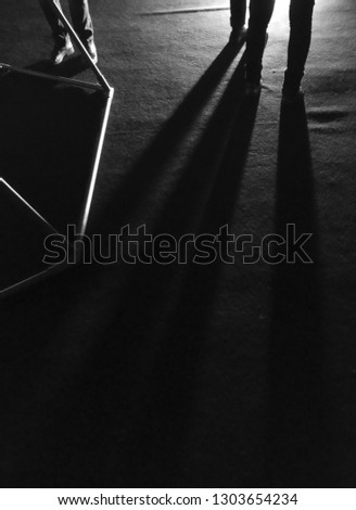 Shadow and light, people and their shadows. Black and white pictorial photography. #1303654234