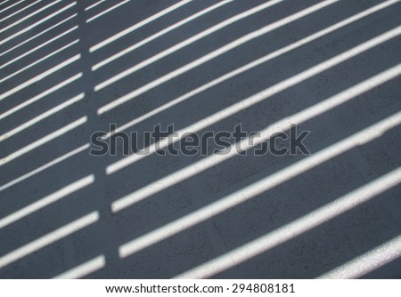 Shadow and Light Striped Pattern\ Floor of a boat during a hot summer day. Pattern made of stripes, light and shadow.