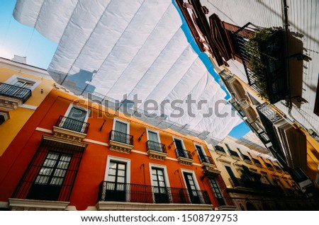 Shadow curtains on the street in Seville, Spain protecting tourists from the harsh sun and heat which is common in the summer in southern Spain Zdjęcia stock ©