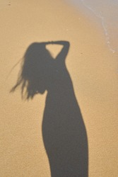shadow from the photographer girl in the sand, silhouette in the sand,