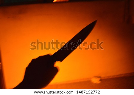 Shadow of a knife or shadow of a killer. horror,