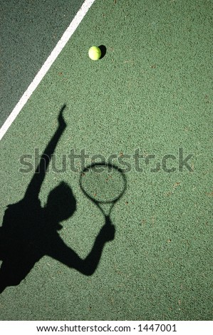 Shadow of a Tennis Player Serving