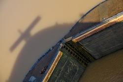 Shadow of bow of ship with sonar antenna above Panama Canal gateway.