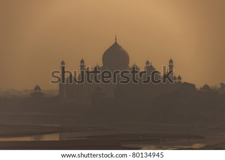Shadow of edifice looms over the Yumana river as seen from Agra city.
