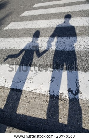 shadow of father and child by the way