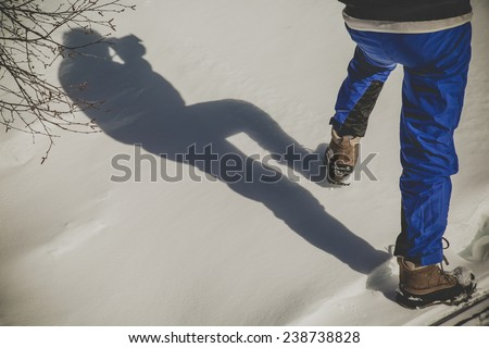 Shadow of man in the sand, running, freedom concept