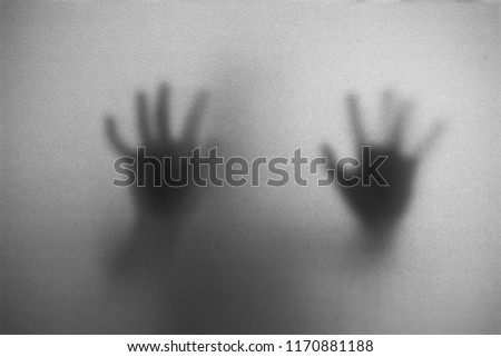 Shadow of man on the white frosted glass representing dangerous, fear, help, haunting, horror and scary. #1170881188