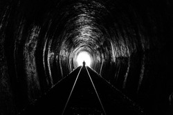 Shadow of Man Standing in the Train Tunnel