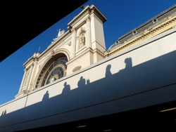 Shadow of people on the wall of The Budapest Keleti Train Station.