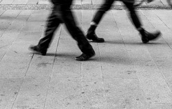 Shadow of People walking in crowded street. Black and White photo of shadow of people. Pedestrian in a street. Blur Shadows of people walking in a street of the city.