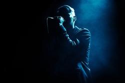 Shadow of singer in light