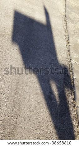 Shadow of suburban mailbox on driveway