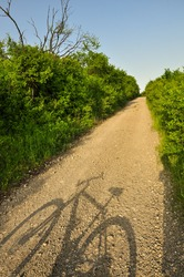 Shadow of the bike on the tourist trail. Sport and tourism. Active lifestyle.